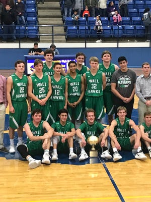 The 2018 Wall High School boys basketball team with their area championship trophy