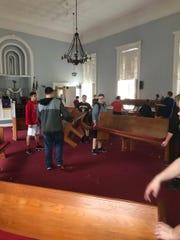 New Richmond's football team moves pews at the Presbyterian