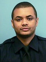 FILE - This undated file photo provided by the Baltimore Police Department shows Detective Sean Suiter. New police leadership is bringing in an outside consultant to review the unsolved slaying of Suiter, portrayed as a hero by everyone from the governor to the city's mayor and police brass. Suitor was killed with his own gun a day before he was set to testify before a grand jury investigating dirty cops. (Baltimore Police Department via AP)