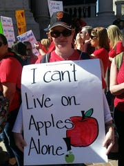 A teacher in Colorado protests April 27, 2018, at the