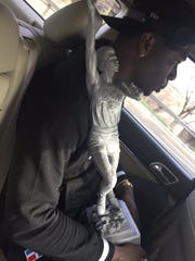 Seton Hall's Angel Delgado cradling the Kareem Abdul-Jabbar Award trophy