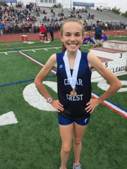 Cedar Crest freshman Gwyneth Young was wearing a huge smile after a strong third place finish in the 1600 meters.