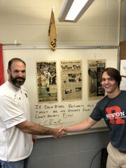 Ruston teacher/coach Chad Reeder shakes hands with