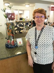 Brenda Rasch, Marco Library manager, with Opi DeFalco's design.