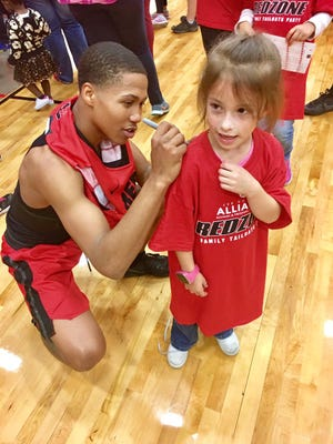 Auburn has received a verbal commitment from  Texas junior college guard J'Von McCormick, shown here signing a jersey for a fan after a game at Lee College.