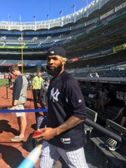 Odell Beckham Jr. steps on to the field at Yankee Stadium before taking batting practice with the Yankees.