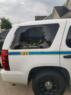 A Hinds County vehicle with the window smashed. A thief stole a shotgun out of the SUV.