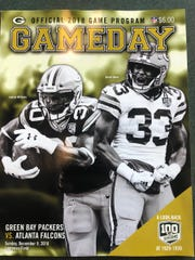 Aaron Jones was on the cover of Green Bay's game program