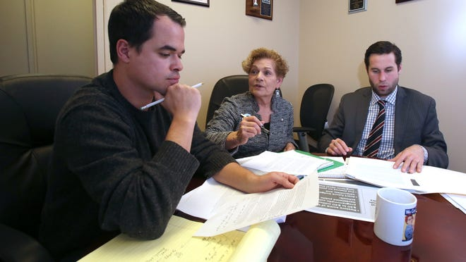 State Sen. David Carlucci, left, and Assembly members Ellen Jaffee and Kenneth Zebrowski meet at Jaffee's office in Pearl River on Friday. They were discussing legislative proposals to help the East Ramapo school district, as recommended by state fiscal monitor Hank Greenberg.