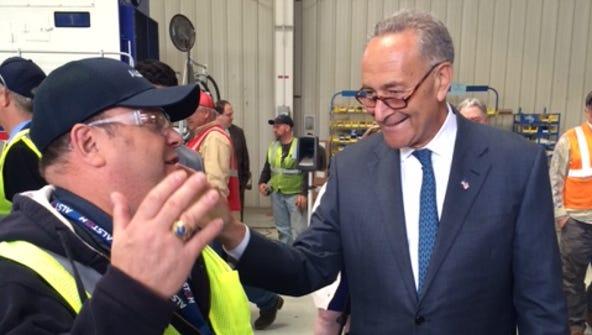 U.S. Sen. Charles Schumer, D-N.Y., greets employees