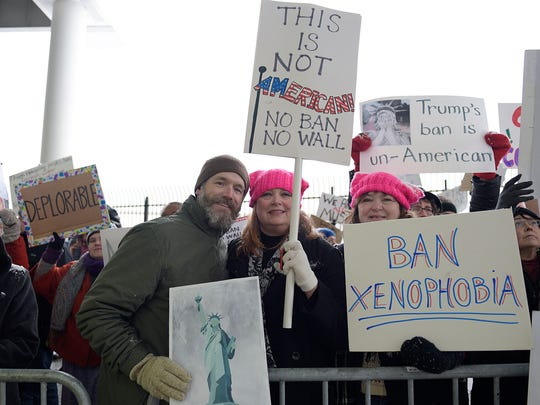 Cassandra Johnson of Canton (middle) took part in the protest with her husband Brian and mother Jennette Kashian of Garden City.
