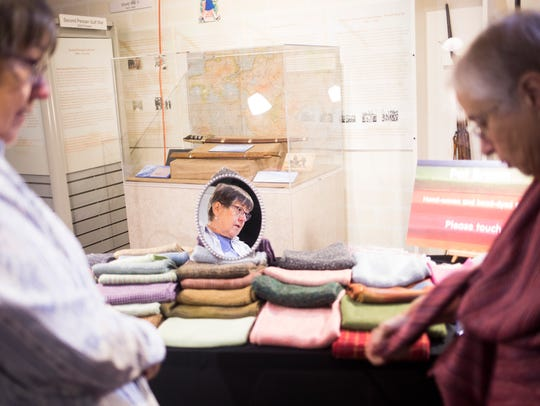 Mary Jane Ames of Anderson checks out a hand-woven