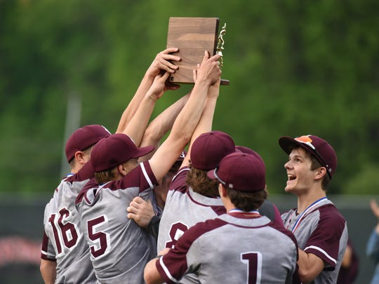 John Glenn players hoist the district championship trophy following the Muskies' 1-0 win against Gnadenhutten Indian Valley on Wednesday at Lake Park.