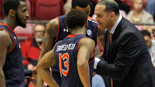 Auburn coach Tony Barbee talks with players during a timeout Saturday in Tuscaloosa. Alabama beat the Tigers 73-57, dropping Barbee to 0-4 against Alabama at Coleman Coliseum.