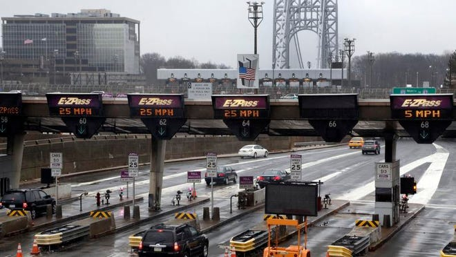Traffic passes through the Fort Lee toll booths at the George Washington Bridge in January. New Jersey Gov. Chris Christie has said he was unaware of any scheme to block local lanes in the town to cause traffic tie-ups.