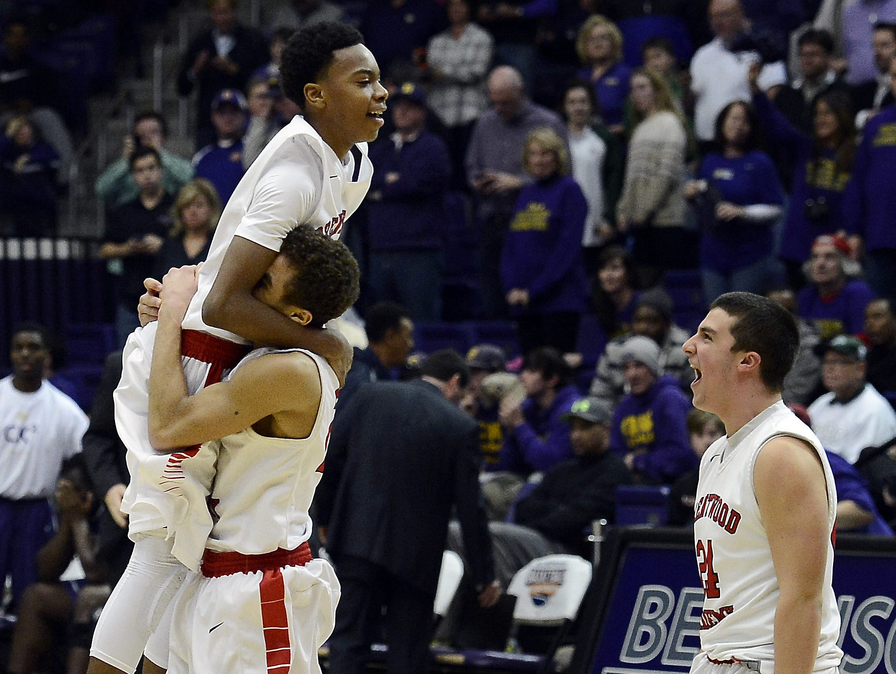 Brentwood Academy's Darius Garland (top), Cam Johnson (holding Garland) and Jack McDonald (right) celebrate after last year's state championship victory.