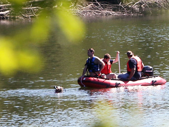 Firefighters from Croton Falls and Mahopac Falls search the waters of the Croton Falls reservoir for a missing fisherman Aug. 19, 2014. The fisherman was found after a 30 minutes search and rushed to Putnam Hospital center where he was pronounced dead.