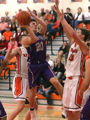 Lexington's Mason Kearns shoots for the basket in during a game at Ashland High school on Friday night.