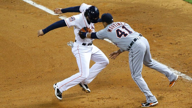 Astros centerfielder Jake Marisnick is picked off of first base as Tigers first baseman Victor Martinez puts on the tag in the 10th inning of the Tigers' win Saturday in Houston.