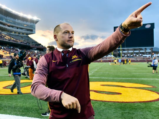 In this Oct. 21, 2017, file photo, Minnesota head coach P.J. Fleck acknowledges the the fans in the students section after a 24-17 victory over Illinois in a NCAA college football game in Minneapolis. The University of Minnesota and Fleck have agreed to a one-year contract extension through the 2022 season.