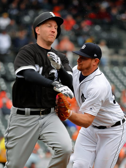Detroit Tigers first baseman John Hicks, right, tags out Chicago White Sox's Todd Frazier on a ground ball in the fourth inning of a baseball game in Detroit, Sunday, April 30, 2017. (AP Photo/Paul Sancya)