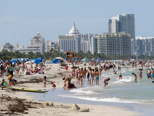 Beachgoers enjoy a day on Miami Beach, Florida's famed