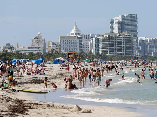 Beachgoers enjoy a day on Miami Beach, Florida's famed