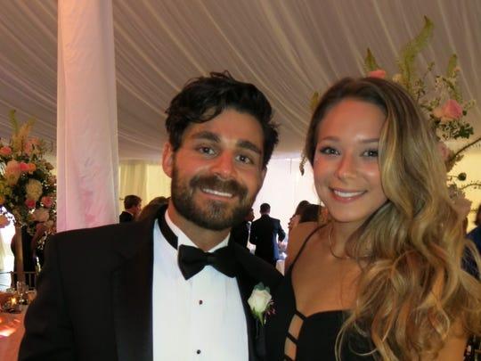 Jake Savage and Amber Crim at wedding reception.