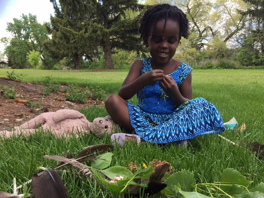 Amara Ochsner gathered leaves, pine cones and goose feathers during a nature walk at Oddsfellow Park.