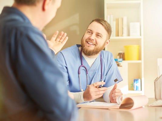 happy gp with patient