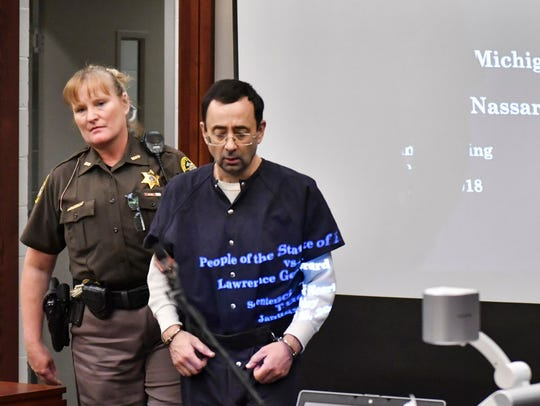 Larry Nassar is led back into circuit court during