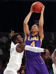 LSU Tigers guard Skylar Mays (4) shoots as Virginia Commonwealth Rams guard JeQuan Lewis (1) defends during the first half in the 2016 Battle 4 Atlantis in the Imperial Arena at the Atlantis Resort.