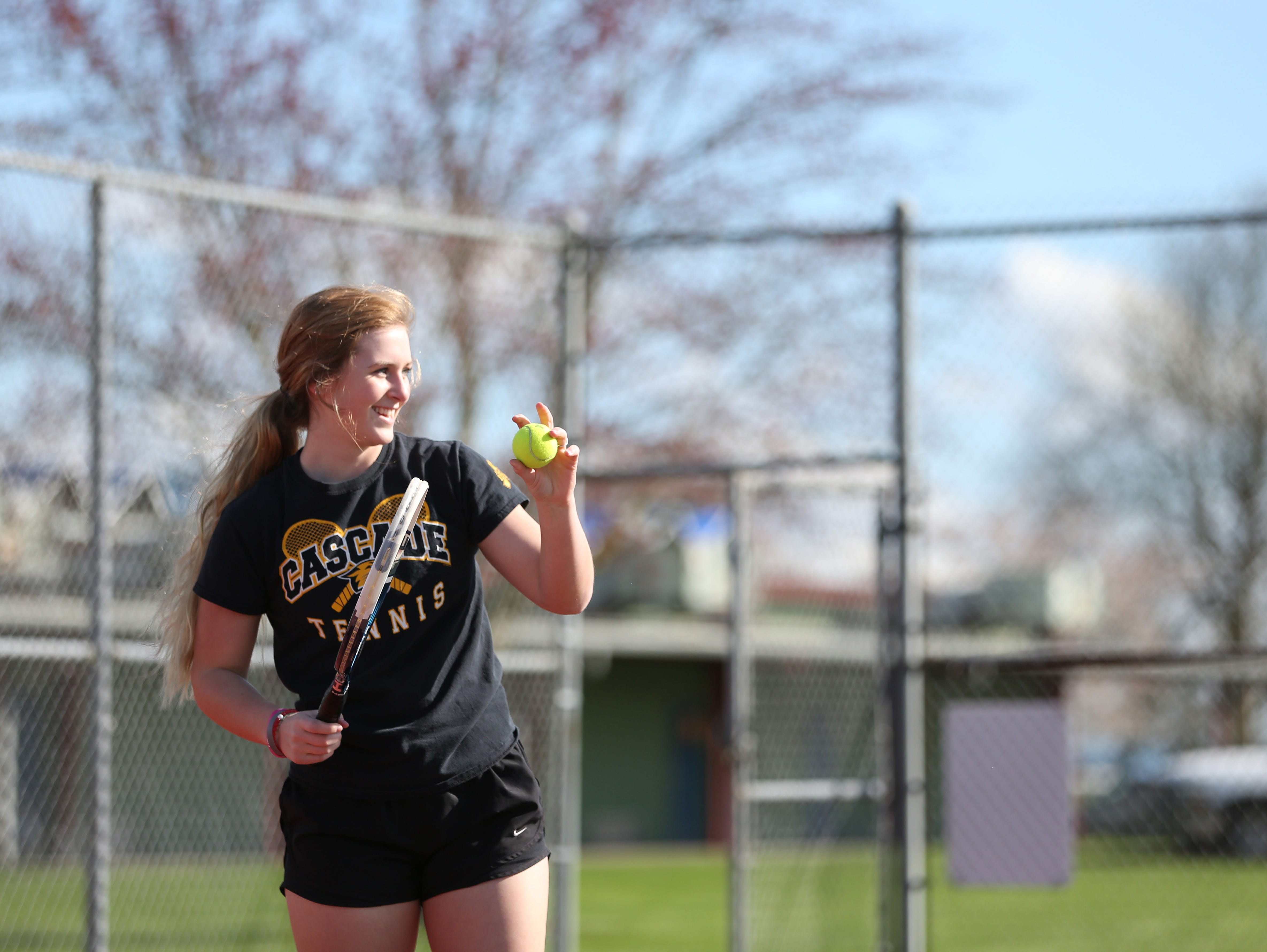 Tori Lewis practices with doubles partner, Jaja Osuna Sola, on Tuesday, March 21, 2017, at Cascade High School in Turner.
