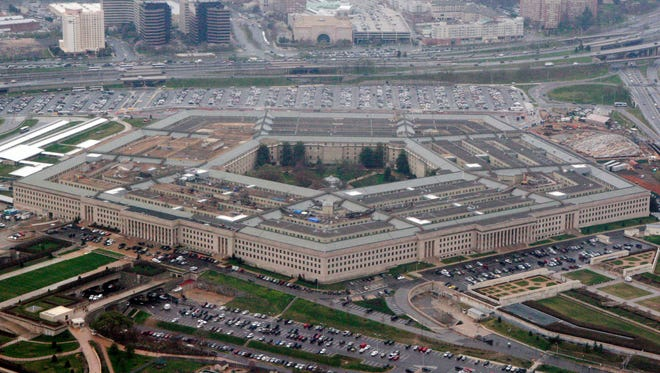 "In this March 27, 2008 file photo, the Pentagon is seen in this aerial view in Washington. President Donald Trump says he will bar transgender individuals from serving ""in any capacity"" in the armed forces. Trump said on Twitter Wednesday, July 26, 2017, that after consulting with ""Generals and military experts,"" that ""the U.S. Government will not accept or allow Transgender individuals to serve in any capacity in the U.S. Military."""