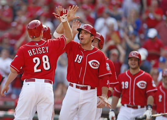Cincinnati Reds' Chris Heisey, 28, is congratulated by Joey Votto, 19, and other teammates as he crosses the plate following his grand slam off Tampa Bay Rays' Josh Lueke during the eighth inning.