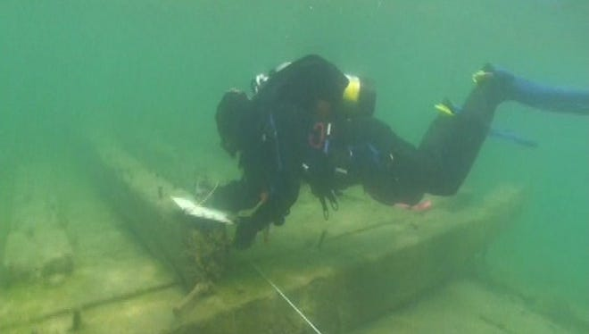 Maritime archaeologist Dan Harrison surveys the wreck of an unidentified 19th century schooner in Lake St Clair.