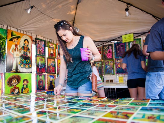 Adriana Vega looks through a selection of printed tiles