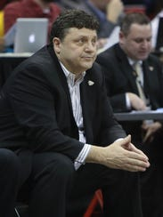 Oakland coach Greg Kampe on the bench during Oakland's