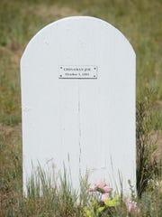 A newly planted grave marks a Chinese worker that died