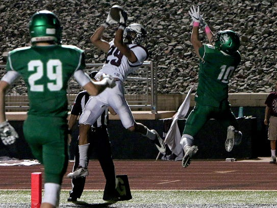 Vernon's Anthony Garza (29) intercepts a pass intended