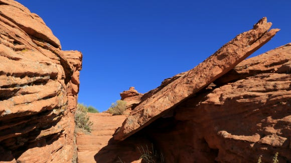 The Owens Loop Trail passes through a few narrow corridors in the red cliffs above downtown St. George.