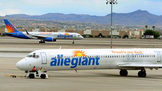 Two Allegiant Air jets taxi at McCarran International Airport in Las Vegas on May 9, 2013.