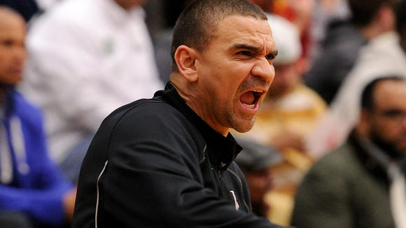 Lawrence Central head coach JR Shelt yells at his team to get back on defense against Arsenal Tech during the Class 4A Sectional #10 at Lawrence North this season. Tech won the game 77-47.