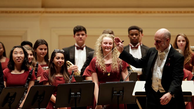 Members of the Marjory Stoneman Douglas High School Wind Symphony stand to receive applause after a performance at Carnegie Hall in New York, Tuesday.