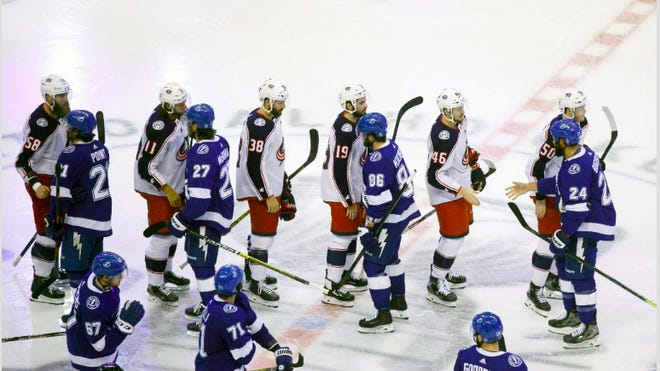 The Blue Jackets and Tampa Bay Lightning shake hands following Game 5 of a first-round playoff series the Lightning won, 5-4, in overtime on Wednesday at Scotiabank Arena in Toronto.