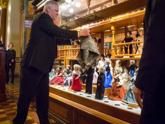 First Spouse Kevin Reynolds unveils a new doll with his face during a ceremony Wednesday, Dec. 20, 2017, at the Iowa Statehouse in the First Doll Display Case.