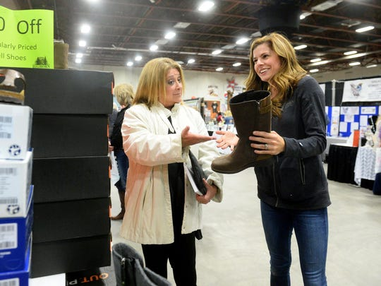 Professional comedian Elayne Boosler, left, jokes with Courtney Frankl of Bighorn Outdoor Specialists at the What Women Want Expo on Friday afternoon.