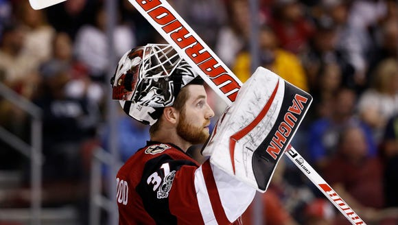 Arizona Coyotes goalie Scott Wedgewood (31) pauses