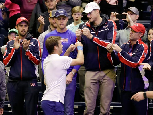 Ryan Harrison, of the United States, celebrates with teammates after beating Ruben Bemelmans, of Belgium, in a Davis Cup quarterfinal singles tennis match Sunday, April 8, 2018, in Nashville, Tenn. The United States clinched the series Saturday to move on to the semifinals. (AP Photo/Mark Humphrey)
