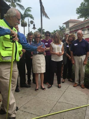 Dan Burden, left, leads a group in Naples last year on a walking tour to talk about ways to make streets more walkable.